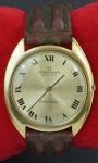 Relógio de pulso Universal Geneve Automatic Golden Shadow, caixa em ouro e pulseira em couro (no estado). Peso total 45 gr
