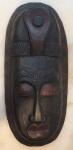 Máscara africana medindo 40x18 cm