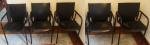Lote composto de cinco cadeiras com braços, estruturas em ferro, assento e encosto em couro (no estado). Medidas 86 x 55 x 57 cm.