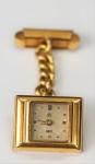 Abotoadura/Relógio, marca UTI Swiss, em ouro, peso total 15.7 gr (relógio não testado)