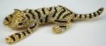 Broche em formtado de tigre, em metal dourada e pedras, med 10 cm, peso 26.9 gr ( bijuteria)