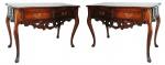 Par de imponentes mesas de encostar de jacarandá mineiro, estilo D. José com 2 gavetas. Medidas 1,18 x 0,55 x 0,80 m.