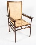 JOAQUIM TENREIRO. Conjunto de quatro cadeiras de braço em jacarandá.