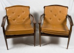 JOAQUIM TENREIRO . Par de poltronas em jacarandá , almofadas soltas em couro natural na cor caramelo.