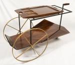 JORGE ZALSUPIN, carrinho de chá, em jacarandá, com rodas em latão, estrutura em ferro pintado de preto