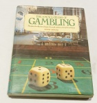 ARNOLD, Peter. The Encyclopedia of Gambling: the game, the odds, the tecniques, the people and places the myths and history. Londown: Collins, 1978. 256 p.: il. col.; 30 cm x 23 cm. Aprox. 1,4 kg. Assunto: Jogos. Idioma: Inglês. Estado: Livro com contracapa e capa dura.
