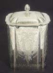 Tea cad em prata 833 contrastada cinzelada. Medida: 13x10, peso 289g.