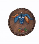 LUNILDES.  Placa em cerâmica com figira de cabeça de boi em policromia, medindo 16 cm de diâmetro. Assinado.