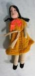 Boneca confeccionada em tecido feito a mão, medindo 33 cm de altura.