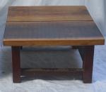 Mesa de centro em madeira nobre. Alt. 36,5 X 73 X 65. Ass. no tampo IS.