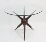 CARLOS MOTTA-   Mesa Não Me Toque, estrutura em jacarandá esculpido e torneado, tampo em vidro. Medidas: base 74 x 60 cm    vidro 100 cm diâmetro.