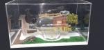 """LEONARDO GRIMBERG. """"Chácara"""", medindo 12,8 x 23 x 14 cm., com caixa de acrílico.  Assinado , numerado e datado, 3 de 2021."""