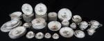 """Aparelho de jantar, chá e café em porcelana francesa de LIMOGES """"SCEAUX""""-  L. BERNARDAUD & Cº, decorado com cenas de paisagem, pássaros e frutas, composto de: 1 sopeira com tampa e presentoir ( 14 x 22 cm), 1 sopeira sem tampa com presentoir ( 10 x 26 cm); 4 bowls ( dois  6 x 24 cm e um 9 x 25 cm); 2 molheiras; 24 pratos fundos ( 24 cm); 48 pratos rasos ( 24 cm); 8 travessas ovais  ( duas 39 x 31 cm, duas 33 x 26 cm e 4 28 x 22 cm); 2 azeitoneiras ( 23 x 12 cm); 48 pratos para sobremesa ( 19 cm); 2 bules para café; 2 bules para chá; 1 leiteira (14 cm); 2 açucareiros com tampa; 2 manteigueiras com tampa; 1 prato para bolo (29 cm); 24 xícaras para chá com 23 pires ( 1 pires quebrado na borda) e 8 xícaras para café com 8 pires ( 1 xícara com fio de cabelo). Total 179 peças."""