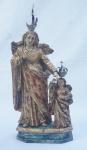 SANT'ANA CAMINHANTE. Imagem portuguesa em madeira policromada e dourada , acompanha 2 coroas. Século XVIII/XIX. Alt. 28 cm .