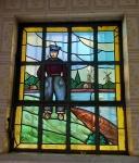 Vitral em formato retangular representando figura masculina e moinhos, com vidros queimados a fogo (junção dos vidros em chumbo), medindo 88 x 73 cm. (peça está chumbada na parede, retirada por conta do comprador)(RETIRADA RUA SANTO CRISTO)