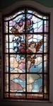 Vitral representando figuras bíblicas, vidros coloridos com pintura queimada (com junções em chumbo), assinado Casa Conrado, São Paulo. Medindo 190 x 98 cm. (peça está chumbada na parede, retirada por conta do comprador) (RETIRADA NA RUA SANTO CRISTO)