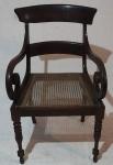 Cadeira de braço em madeira nobre e palha indiana, medindo 88 x 51 x 51 cm. No estado. Necessita restauro.